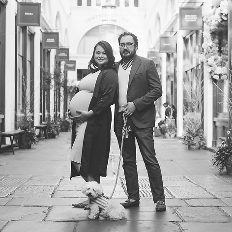 """Expectant Jean and husband Rohit pose with their gorgeous dog in Covent Garden London for a family portrait captured by Aurélie """"Photobya4"""" Four"""
