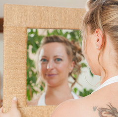 "A bridge admires her makeup and hair in a mirror captured by Aurélie ""Photobya4"" Four"