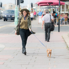 "Courtney and Tuna the Chiweenie aka @tunameltsmyheart walk in the streets of Brighton, captured by Aurélie ""Photobya4"" Four"