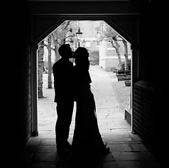 "Newly weds kiss in London in a silhouette portrait of them similar to a ""Disney"" picture"
