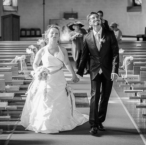 """Gwen and new husband walk hand in hand with happy smiles whilst exiting the church where they just had their religious wedding in France, captured by Aurélie """"Photobya4"""" Four"""