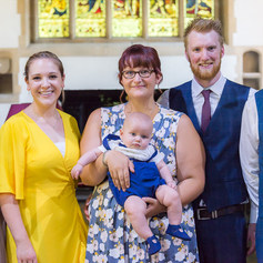 """A family portrait at the baptism of baby Dexter with his mother, father and godparents captured by Aurélie """"Photobya4"""" Four in Reading"""