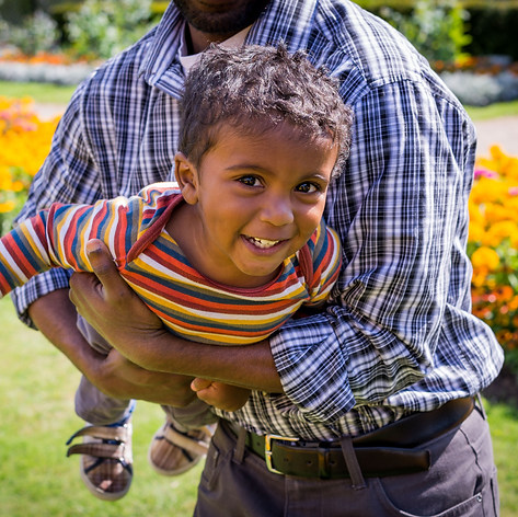 """A father plays aeroplane with his son in a London park surrounded by flowers during a family photoshoot captured by Aurélie """"Photobya4"""" Four"""