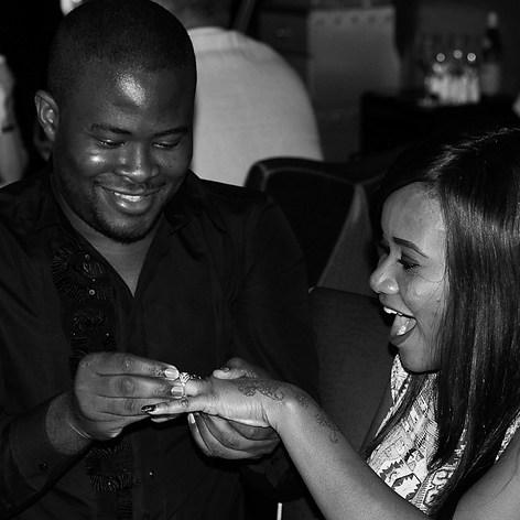 """A surprise proposal captured in Dubai at the Burj Al Arab restaurant captured by Aurélie """"Photobya4"""" Four"""