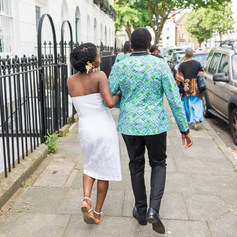 """Same sex couple W and V walk hand in hand in Islington after their civil town hall ceremony captured by Aurélie """"Photobya4"""" Four"""