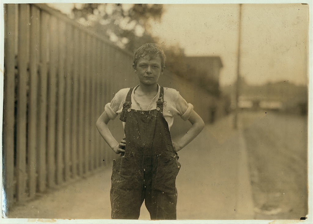 Young worker in Merchants Mill. Location: Fall River, Massachusetts / Lewis W. Hine.