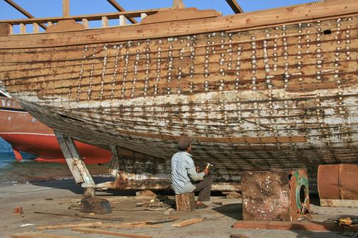 Repairing fishing boats, Al Khor Harbour, Qatar