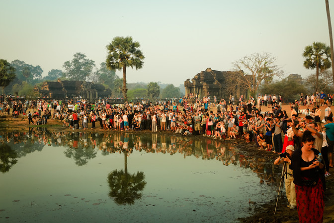 Crowds watching sunrise, Angkor Wat, Cambodia