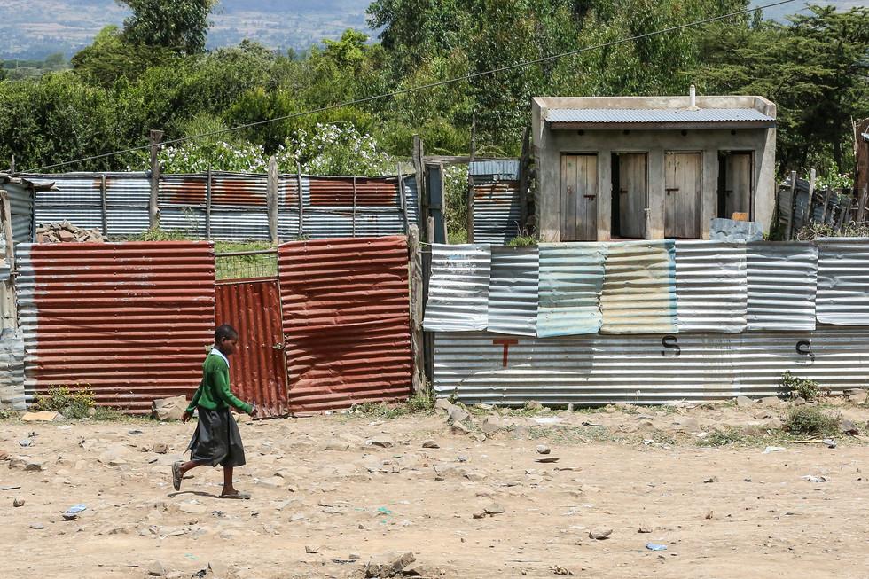 School girl walking home, Masai Mara, Kenya