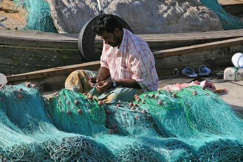 Repairing fishing nets, Al Khor Harbour, Qatar