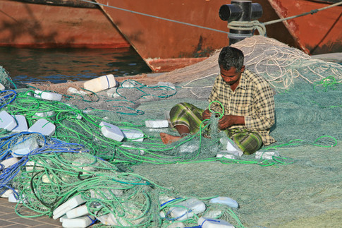 Repairing fishing nets, Al Khor Harbour, Qatar