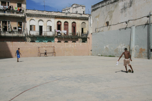 Playing football, Havana, Cuba