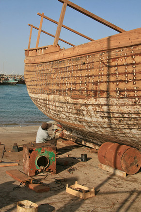 Repairing fishing boats, Al Khor Harbour, Qatar