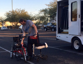 VA Patient transfer to hand cycle.jpg