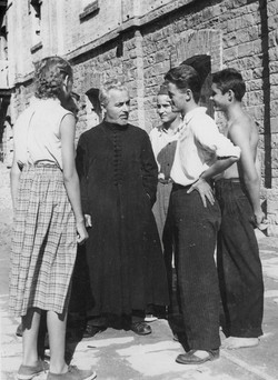 San Sabba Orthodox Priest, Father Sevcenko with some young refugees 1950-51