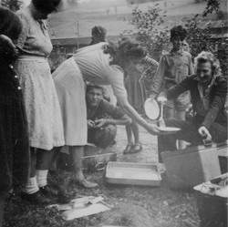 Waiern Summer Camp, Camp Leader Clare McMurray dishing up to Elka Sept.1949