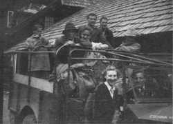 Eisenerz camp staff, Clare McMurray at the wheel, CBSRA jeep 1948