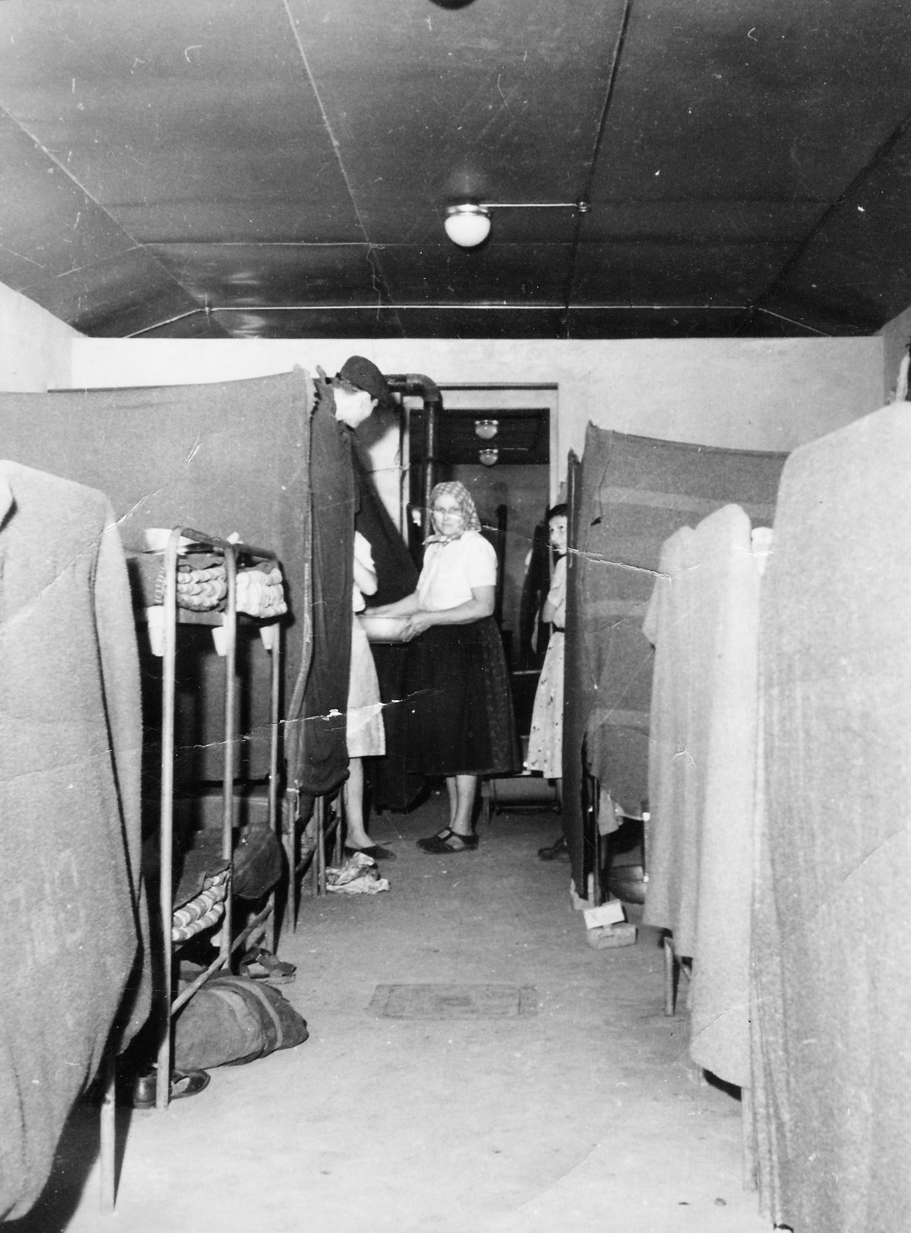 Opincina camp, new barracks, blankets around beds for privacy 1950-51