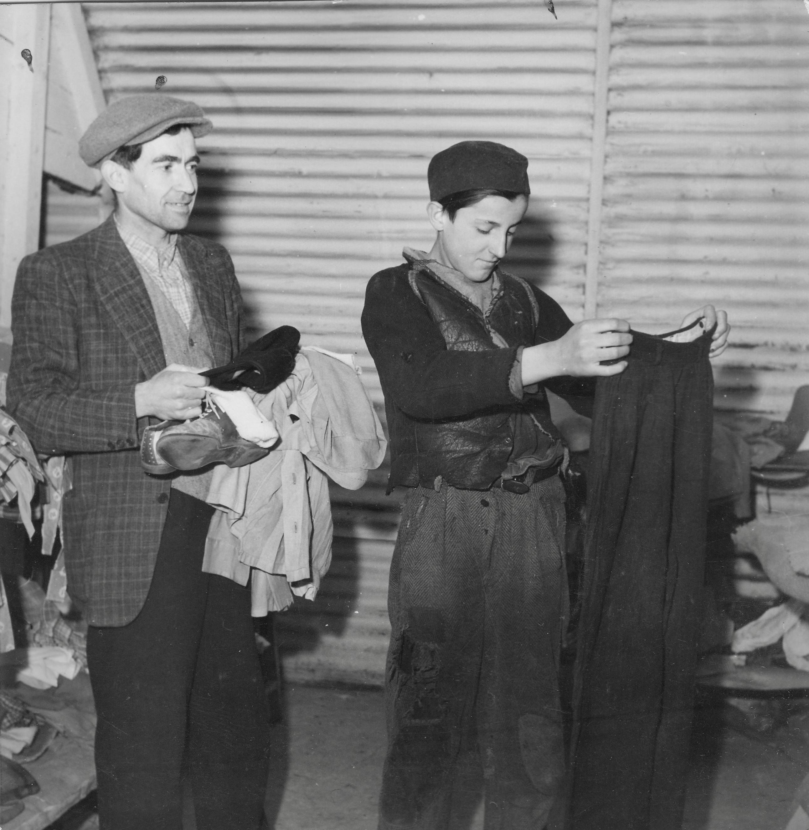 San Sabba, Hungarian boy (16 yrs) just across the border receives a pair of pants 1950-51