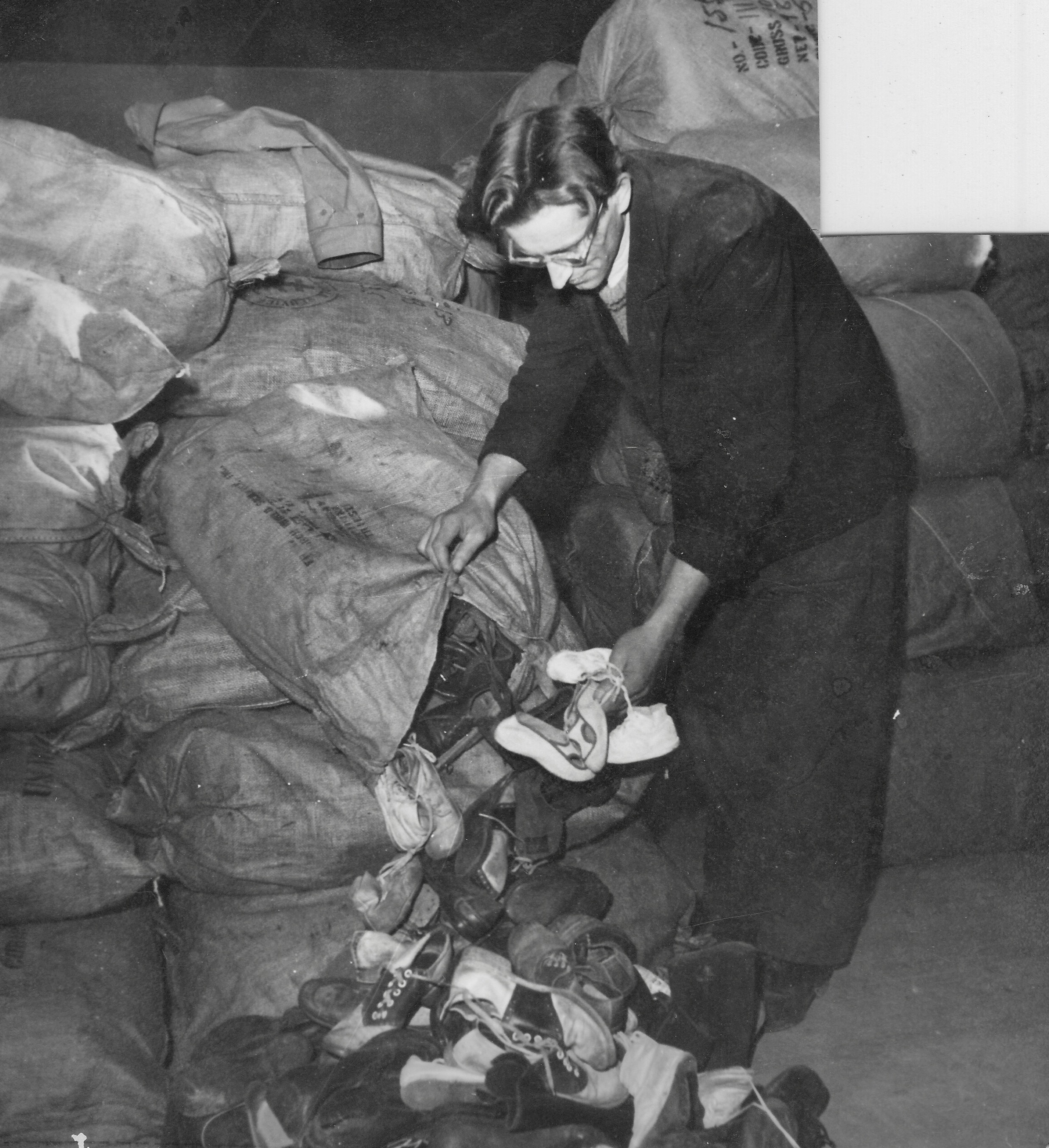 San Sabba, sorting through shoes from America 1950-51