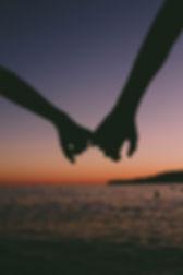 backlit-beach-couple-1378723.jpg