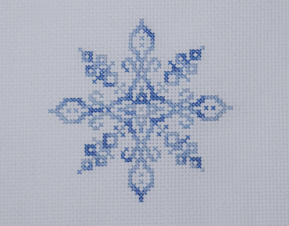 snowflake stitched in blue variegated threads