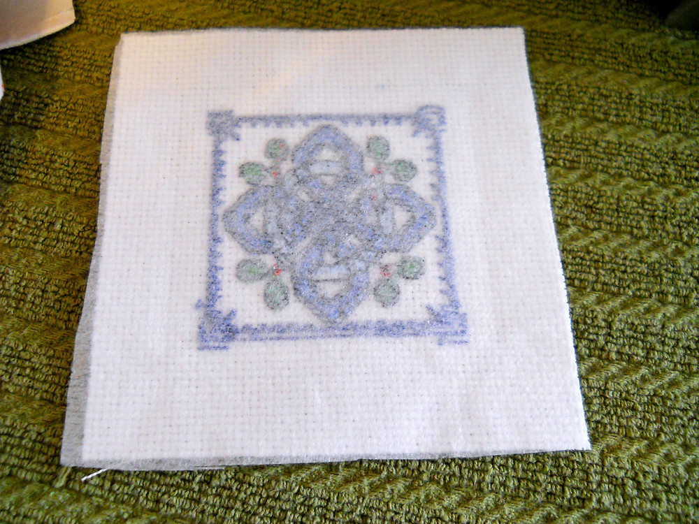 back of cross stitching with iron-on interfacing