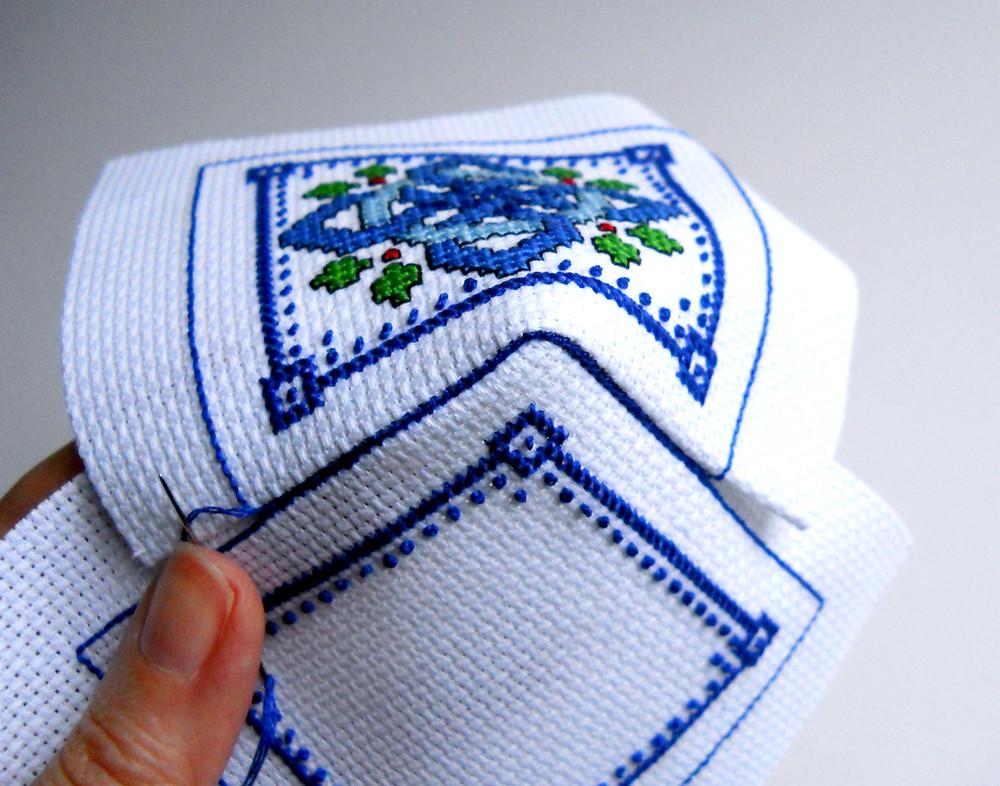 close up of cross stitched biscornu sewn together