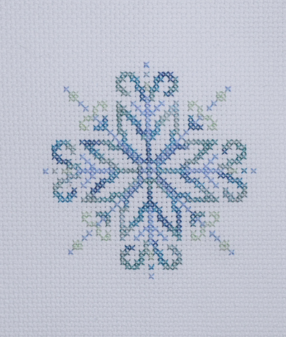 Cross stitched snowflake design stitched with sulky threads