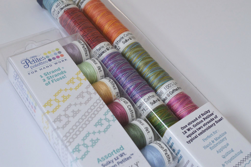 two packages of Sulky threads