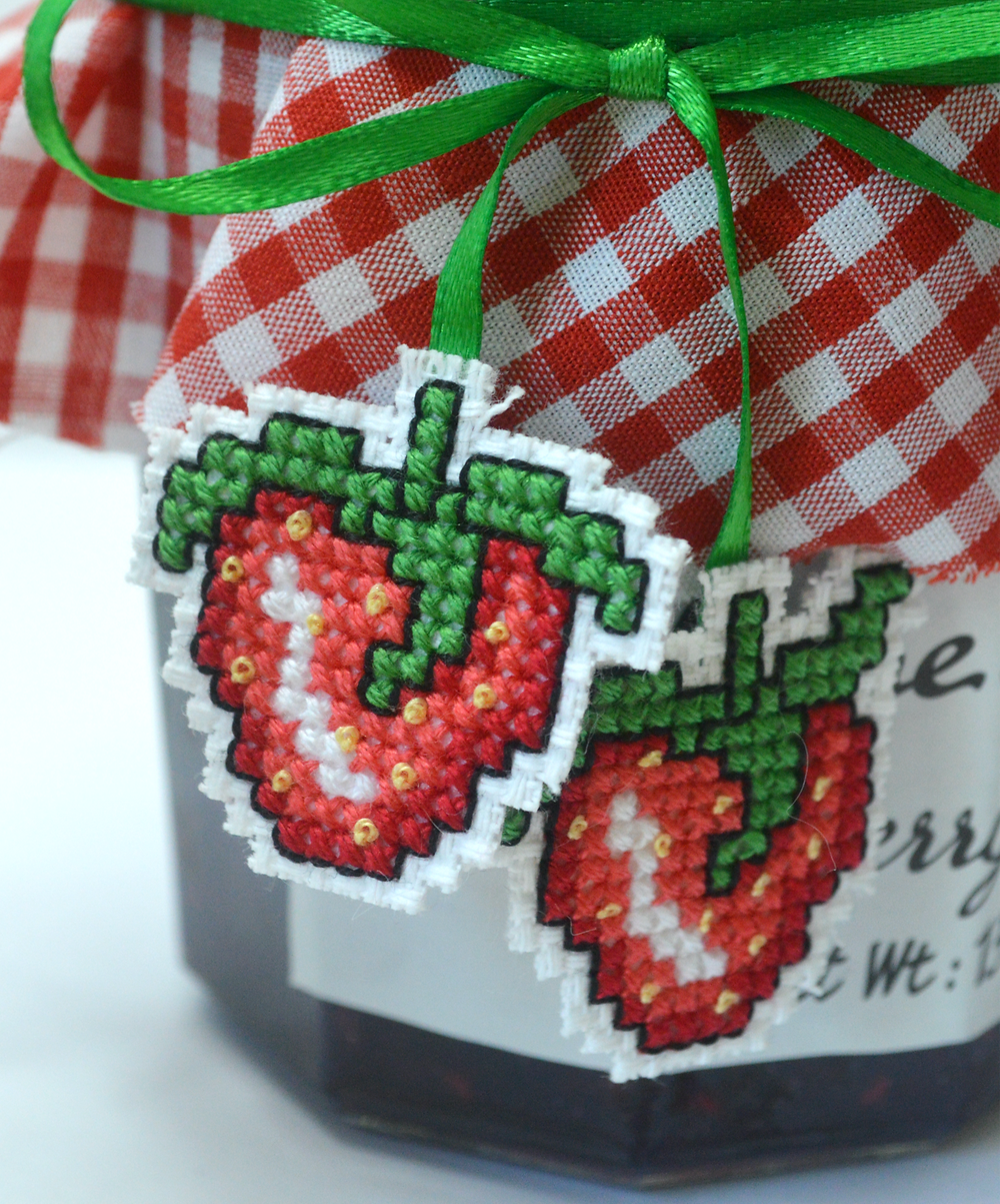 close up of cross stitched strawberries