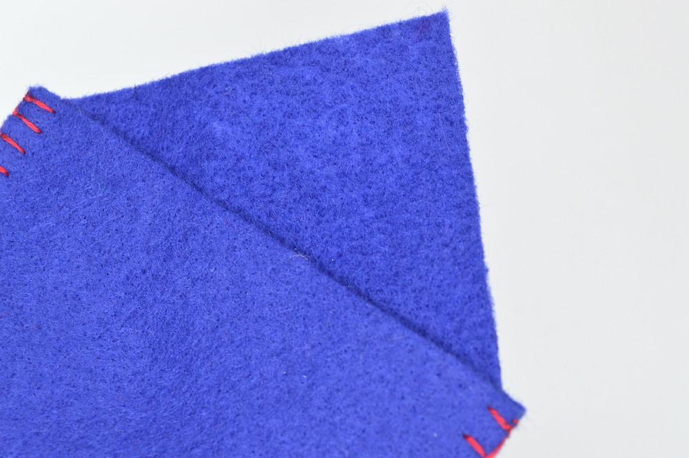 Blanket stitching on a cross stitch gift card holder.
