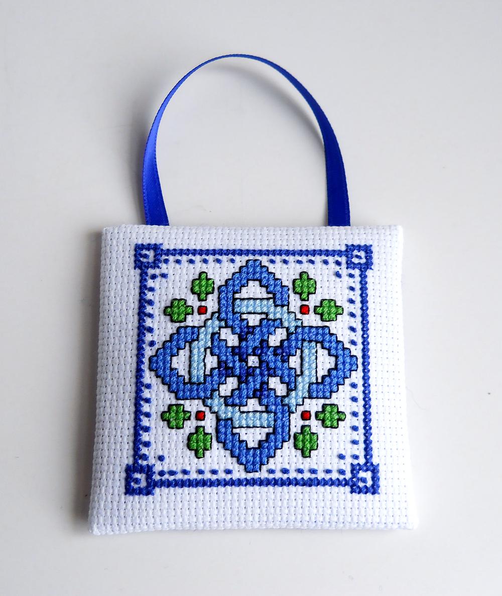 close up of celtic knot cross stitch ornament