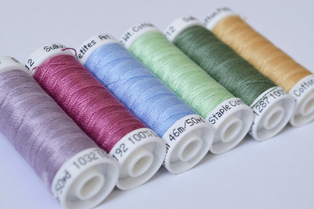 close up of a line of sulky threads