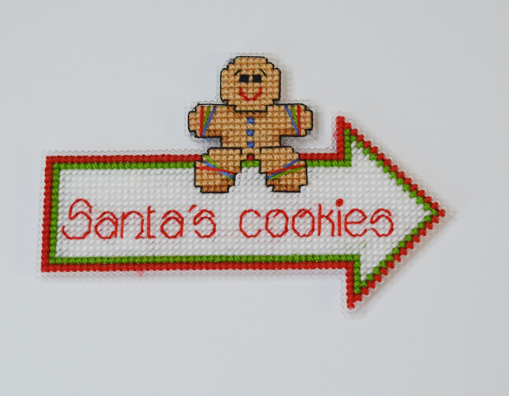 A Christmas cross stitch design with a gingerbread man.