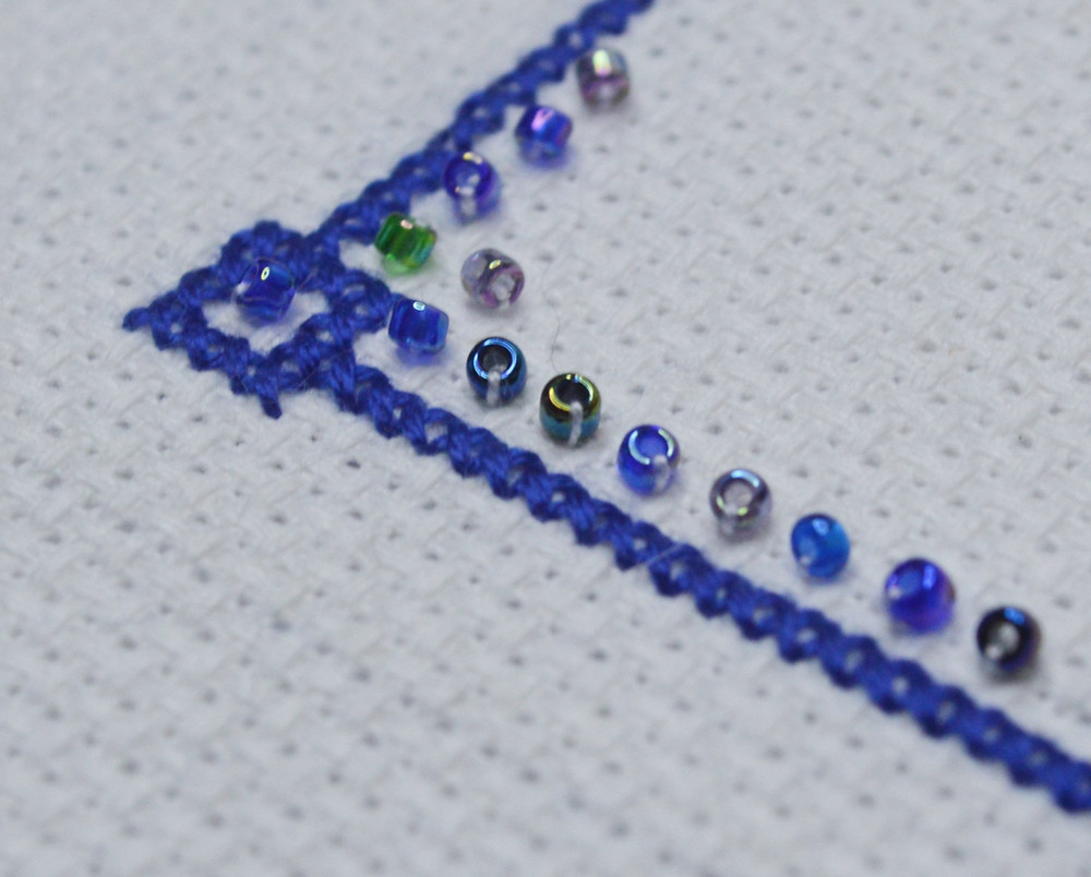 cross stitch border with some seed beads
