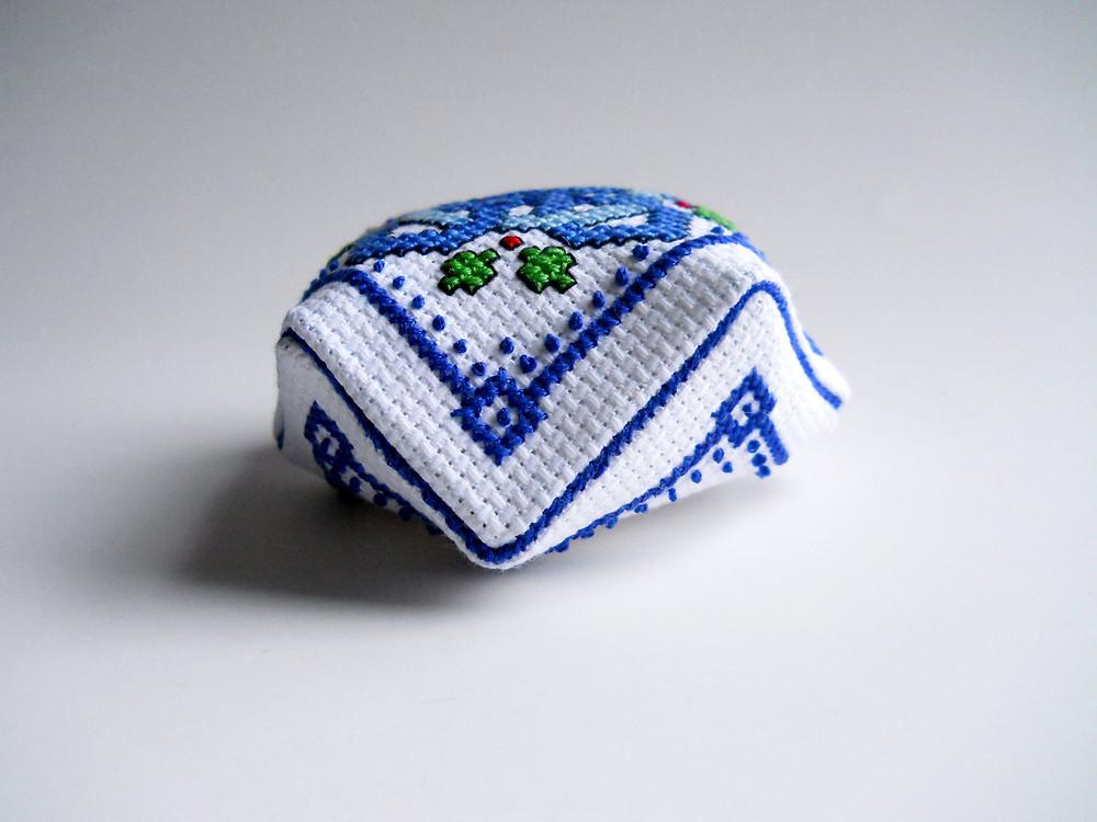 cross stitched biscornu sewn together