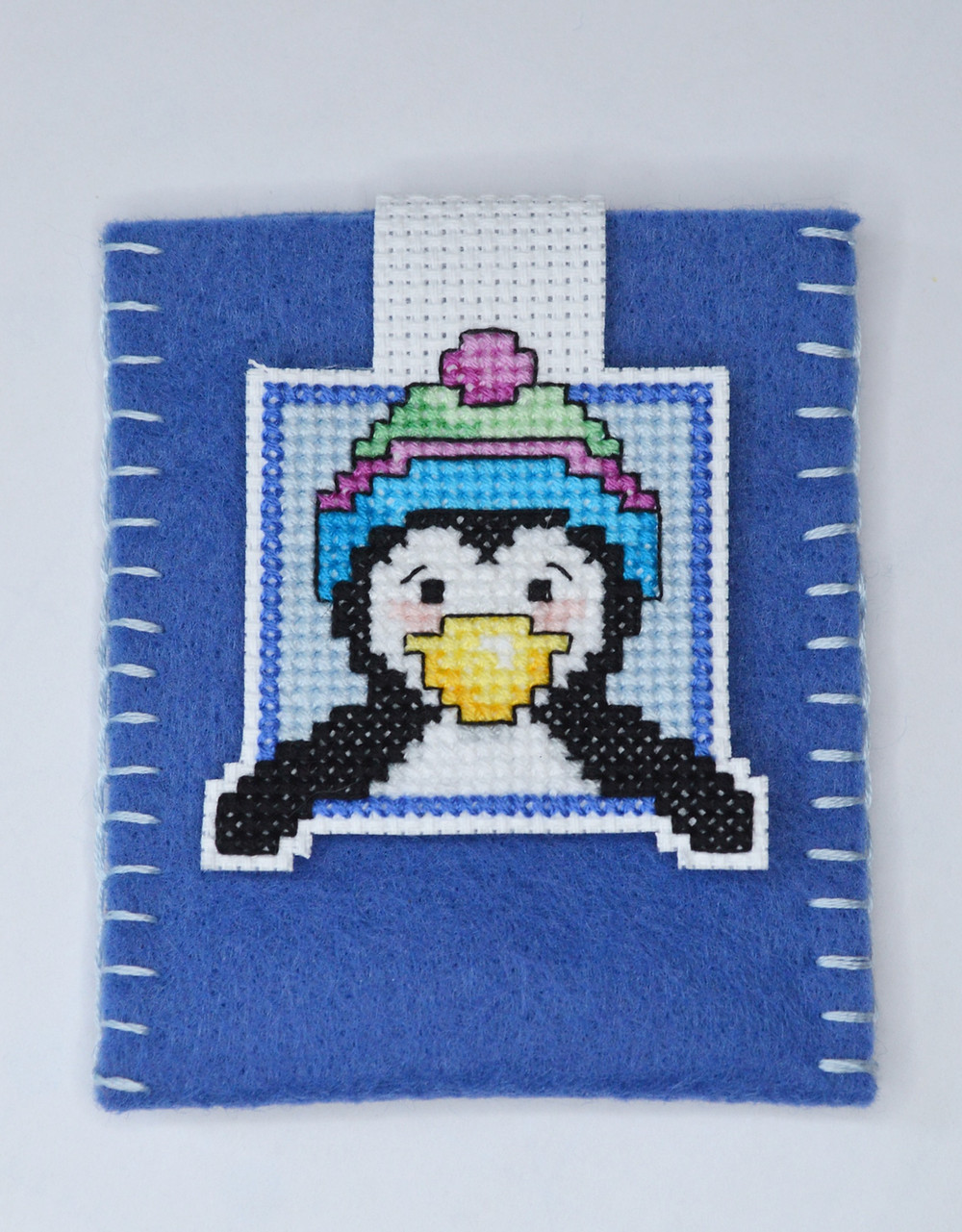 cross stitch penguin as a gift card holder