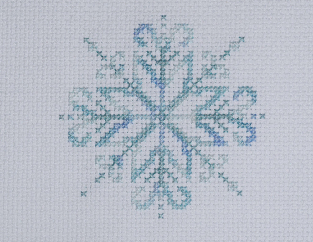 Cross stitch snowflake design stitched with variegated threads
