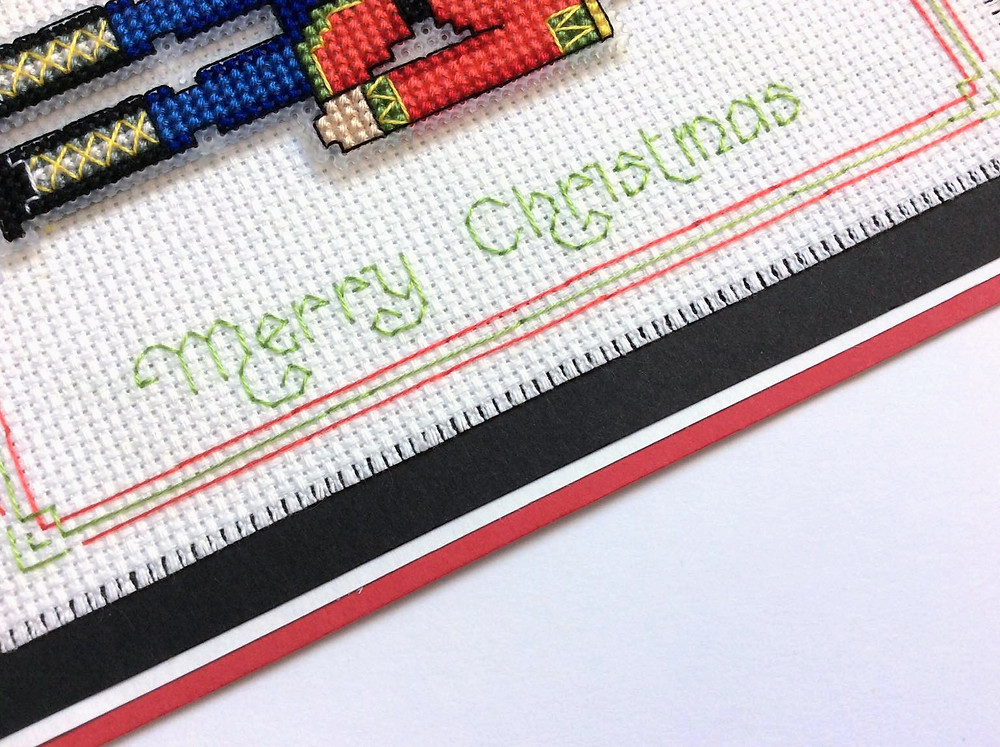 close up of greeting on a cross stitched Christmas card