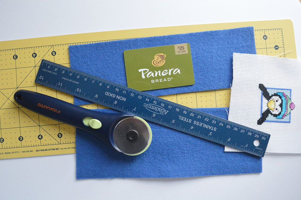 Supplies needed to turn your cross stitching into a gift card holder.