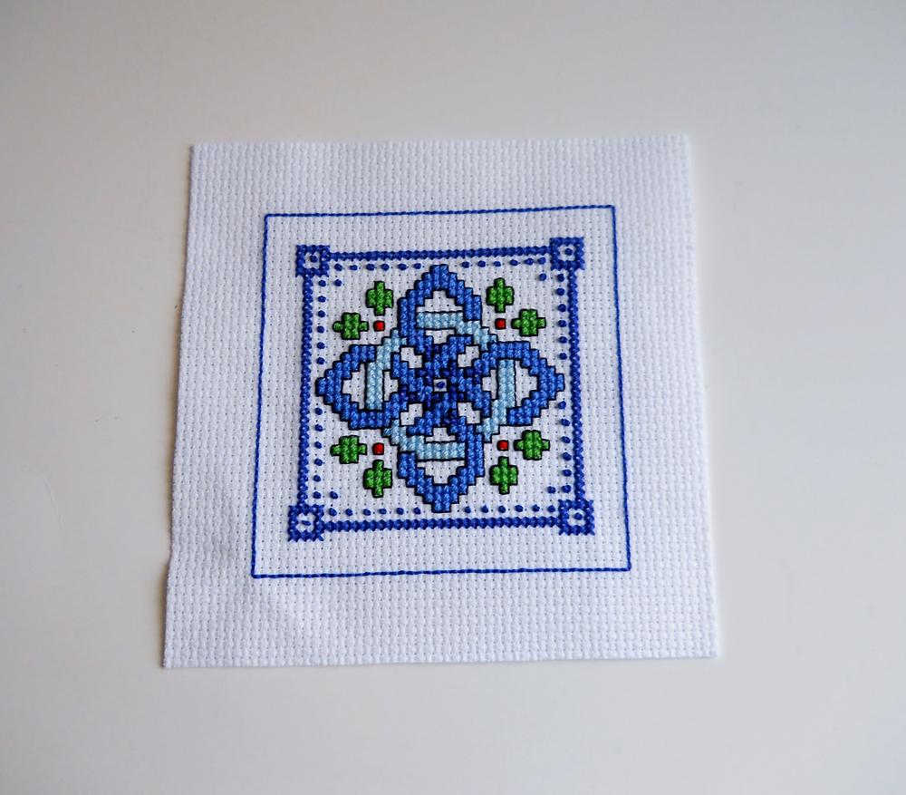 cross stitched celtic knot design with backstitch border