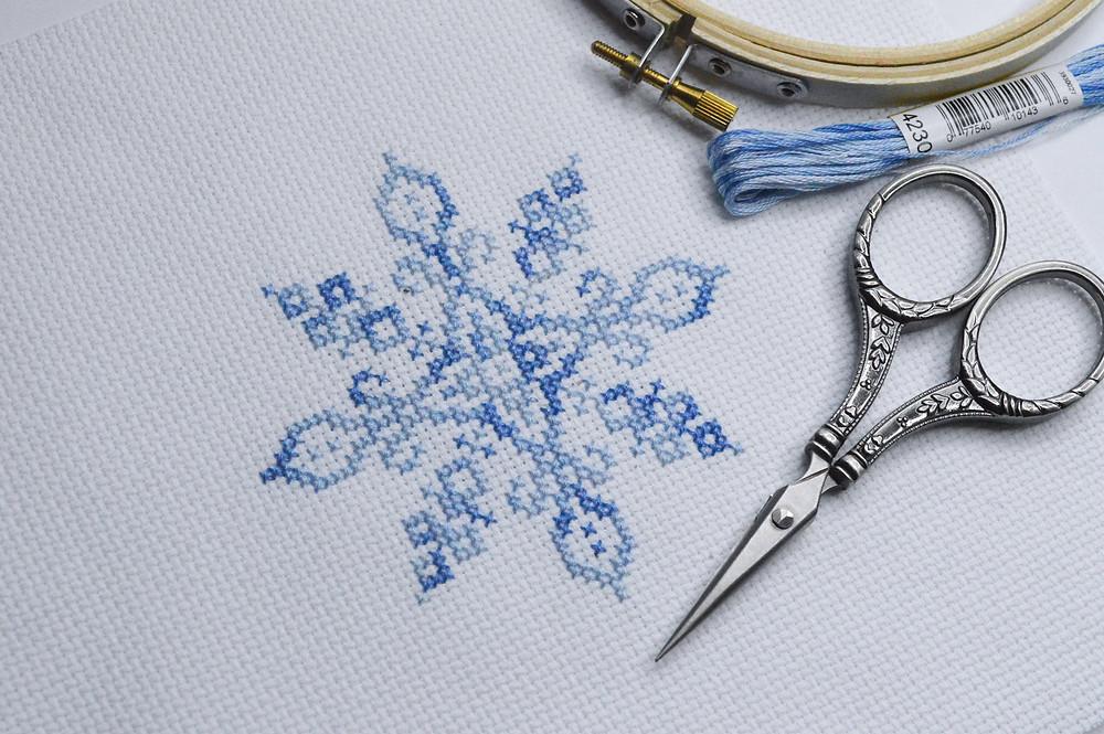 snowflake cross stitch with stitching supplies