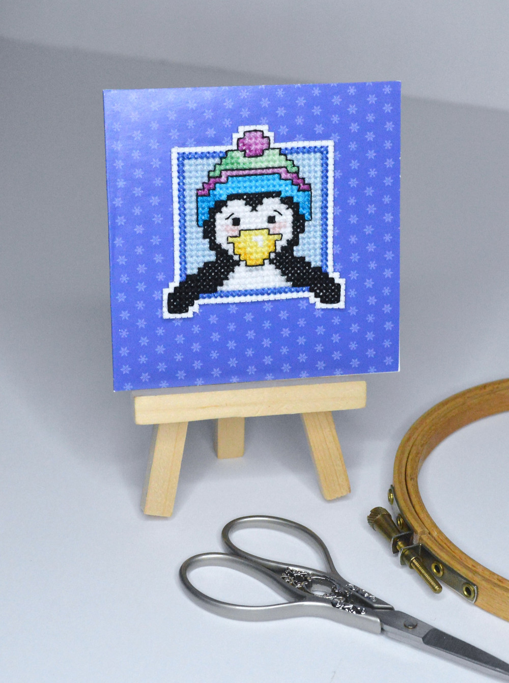 cross stitched penguin made as a card