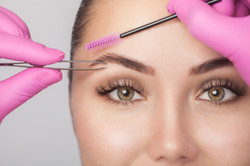 Brow Shaping with wax and tweezers