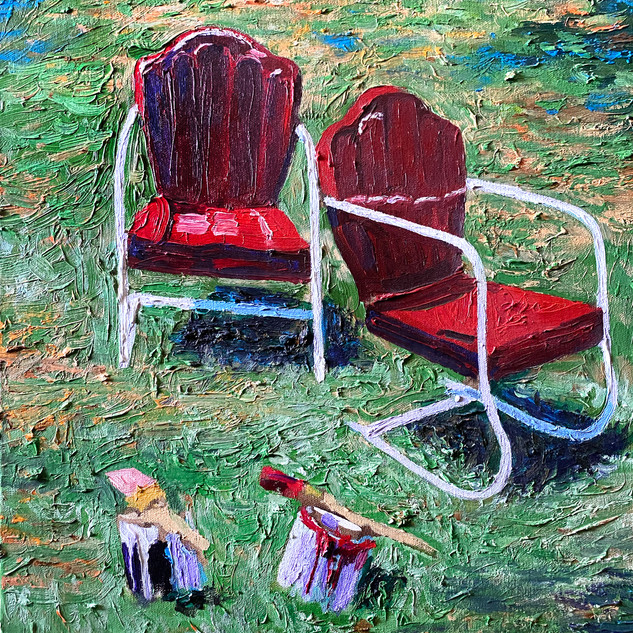 Red Lawn Chairs on Grass