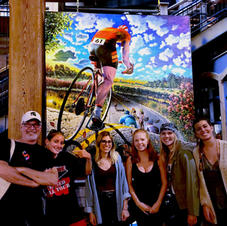 """Karl with """"Chasing the Pack"""" at Artprize, 2018, with Karl's former MSU students Hannah, Gillian and friends."""