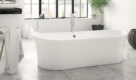 White bathtub in a spacious bathroom