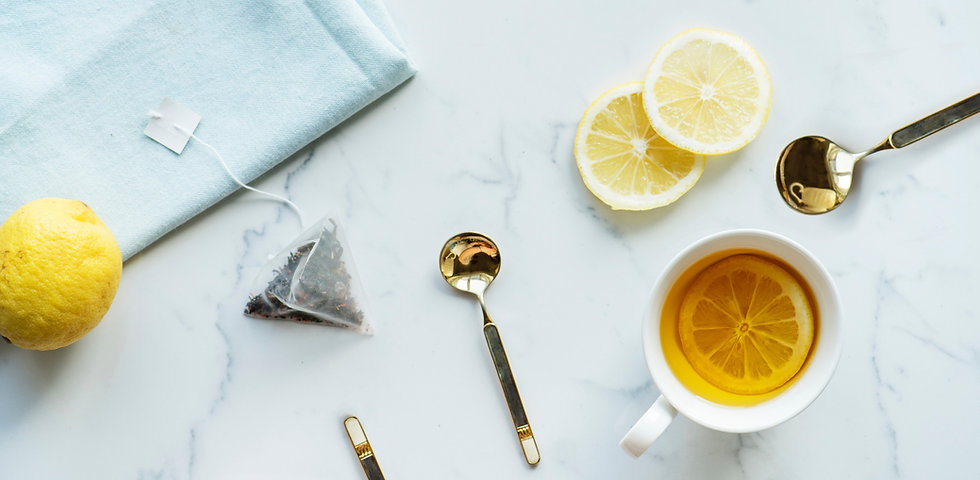 Marble countertop with gold cutlery and tea cups