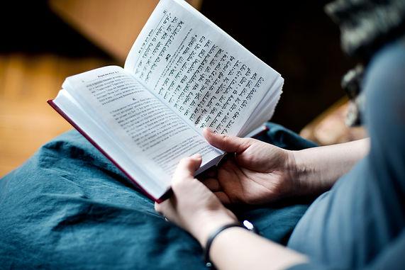 Hands holding a prayer book
